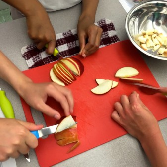 Kids chopping apples on eatlivetravelwrite.com