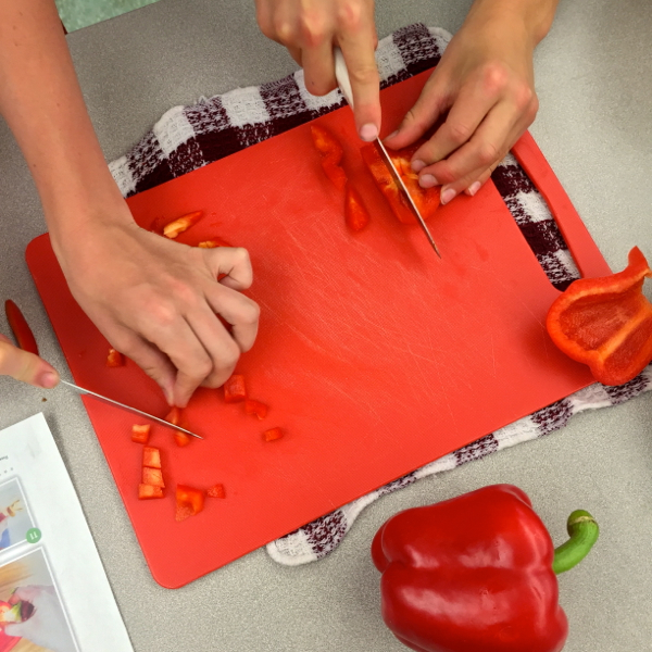 Kids chopping peppers on eatlivetravelwrite.com