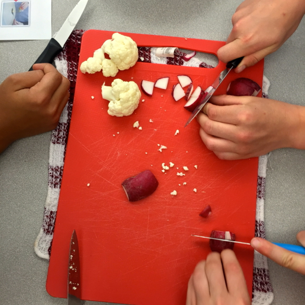 Kids chopping radishes and cauliflower on eatlivetravelwrite.com