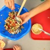 Kids making Jamie Oliver Squash It Sandwich on eatlivetravelwrite.com