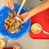 Kids making Jamie Oliver Squash It Sandwich on eatlivetravelwrite.com