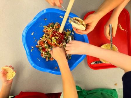 Kids making and filling Jamie Oliver Squash it Sandwich on eatlivetravelwrite.com