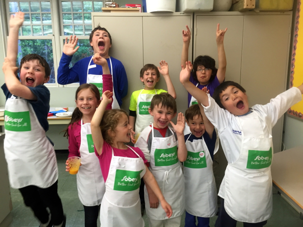 Happy kids at Food Revolution Day parent child cooking class on eatlivetravelwrite.com