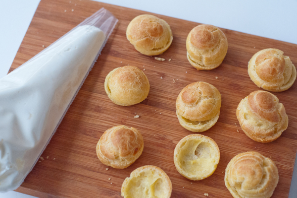 Filling cream puffs on eatlivetravelwrite.com