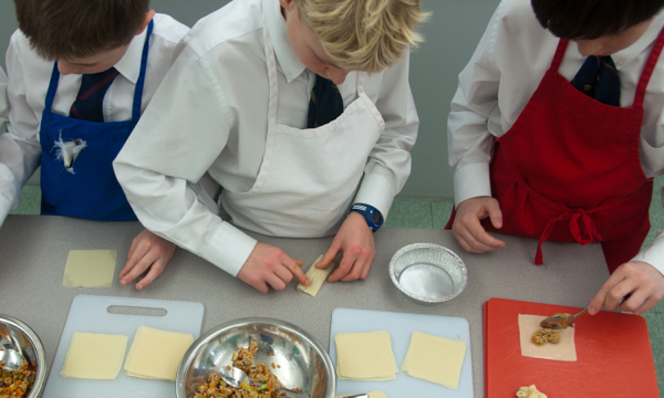 Kids assembling Asian dumplings on eatlivetravelwrite.com