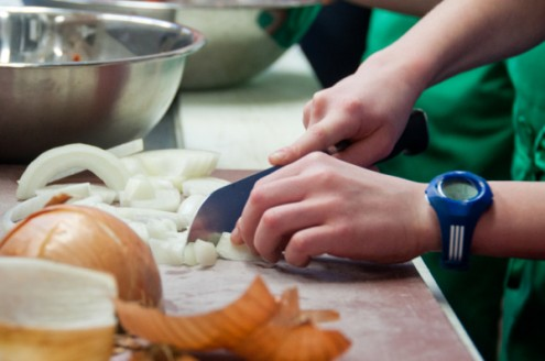 Kids chopping onions with a chef's knife on eatlivetravelwrite.com