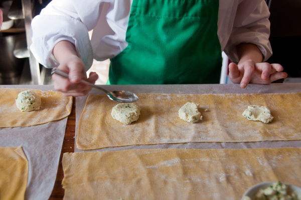 Kids making ravioli from scratch on eatlivetravelwrite.com