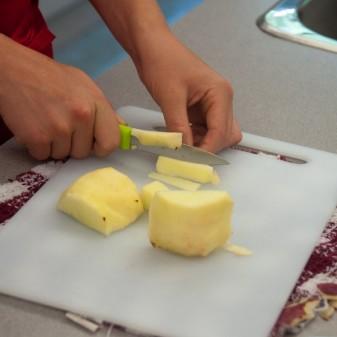 Kids slicing apples on eatlivetravelwrite.com