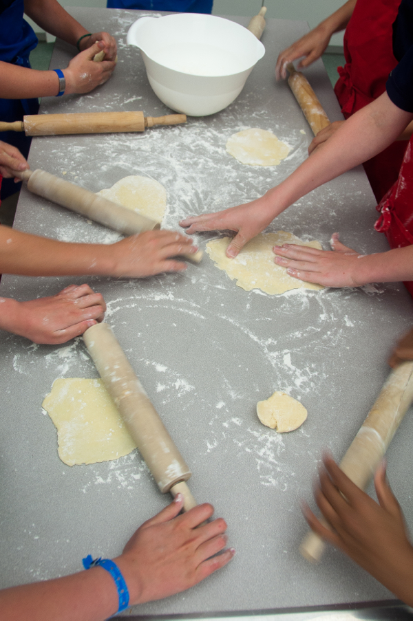 Kids rolling pastry circles for galettes on eatlivetravelwrite.com