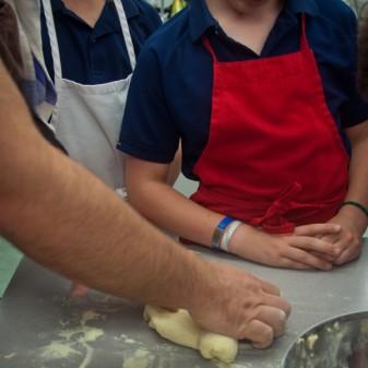 Massimo Bruno kneading pasta dough on eatlivetravelwrite.com