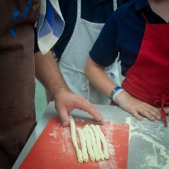 Massimo Bruno cutting pasta dough on eatlivetravelwrite.com