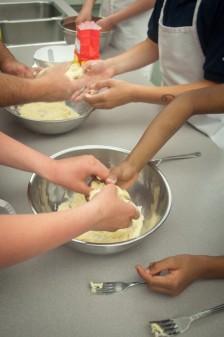 Kids making fresh pasta dough on eatlivetravelwrite.com