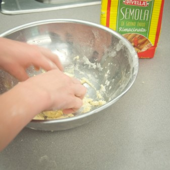 Kids making cavatelli from scratch on eatlivetravelwrite.com
