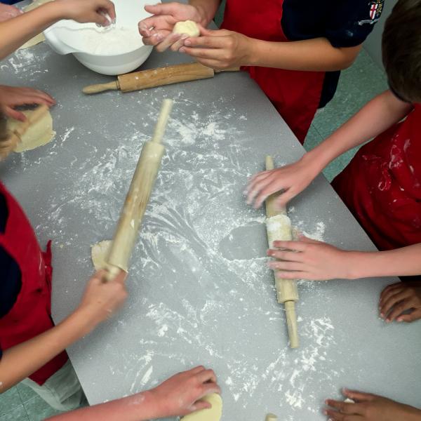 Kids rolling pastry for galettes on eatlivetravelwrite.com