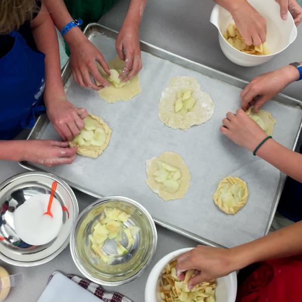 Kids making apple galettes on eatlivetravelwrite.com