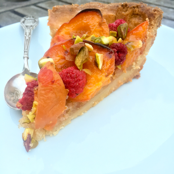 Slice of Dorie Greenspan apricot raspberry tart on eatlivetravelwrite.com
