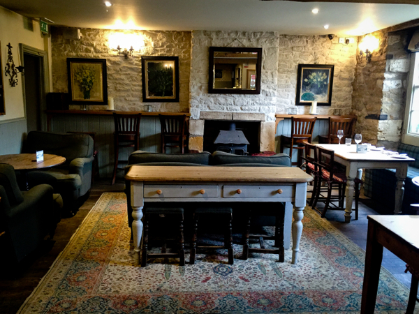 The Kingham Plough pub room on eatlivetravelwrite.com