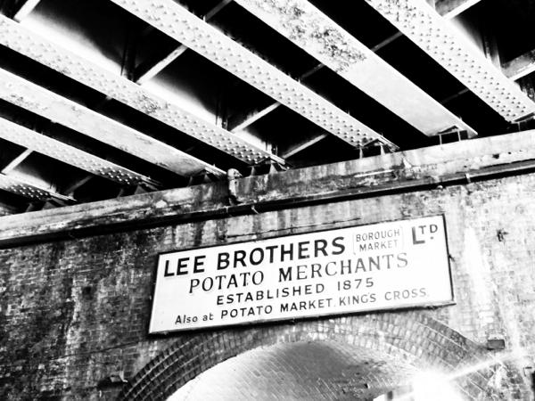 Potato merchants sign at the Borough Market on eatlivetravelwrite.com