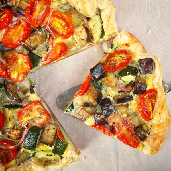 Slice of ratatouille quiche on eatlivetravelwrite.com