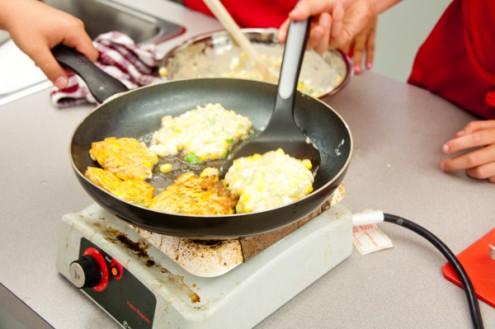 Kids flipping pancakes on eatlivetravelwrite.com