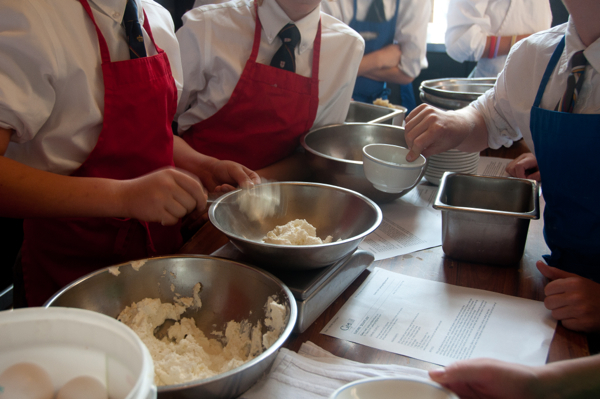 Kids weighing souffle ingredients on eatlivetravelwrite.com