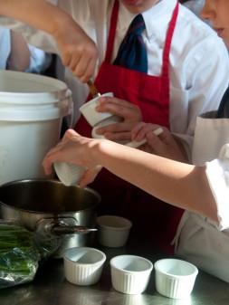 Kids buttering ramekins on eatlivetravelwrite.com