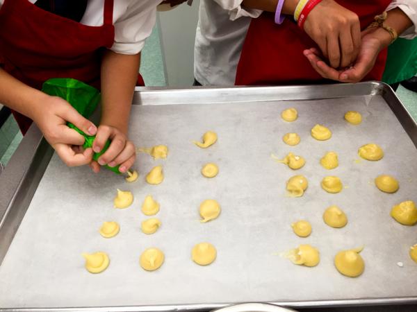 Kids making Edd Kimber's chouquettes on eatlivetravelwrite.com