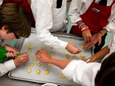 Kids making chouquettes from Edd Kimber Patisserie Made Simple on eatlivetravelwrite.com