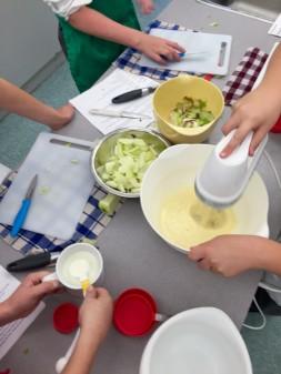 Kids making Dorie Greenspan's custardy apple squares on eatlivetravelwrite.com