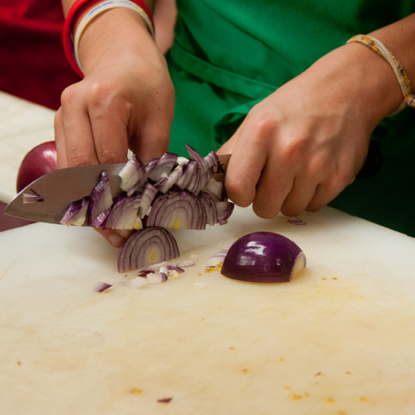 Kids chopping red onions on eatlivetravelwrite.com