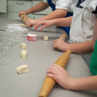 Kids rolling out Mairlyn Smith cream cheese pastry on eatlivetravelwrite.com