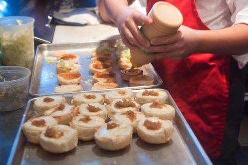 Kids assembling sliders at Mata Bar Toronto on eatlivetravelwrite.com