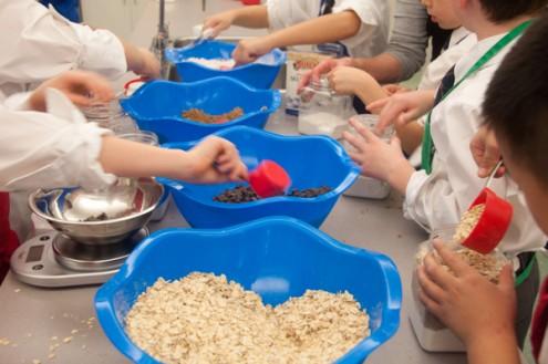 Kids assembling Ricardo Cookie in a Jar Kit cookies on eatlivetravelwrite.com