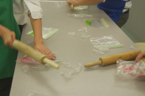 Kids crushing candies with rolling pins on eatlivetravelwrite.com