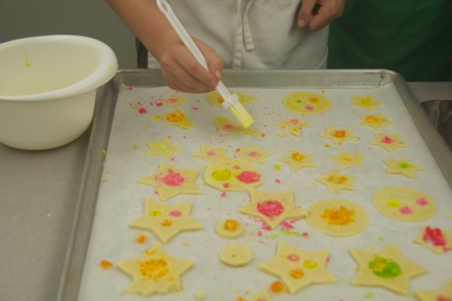 Egg washing stained glass cookies on eatlivetravalwrite.com
