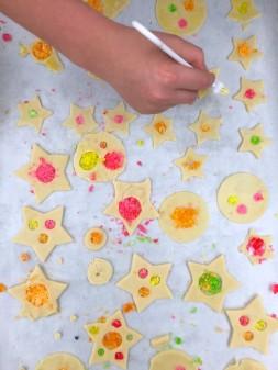 Kids egg washing Dorie Greenspan stained glass cookies on eatlivetravelwrite.com