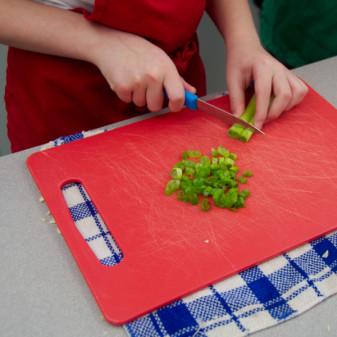 Kids chopping spring onions for soup on eatlivetravelwrite.com