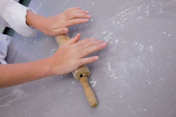 Kids rolling dough for flatbread on eatlivetravelwrite.com