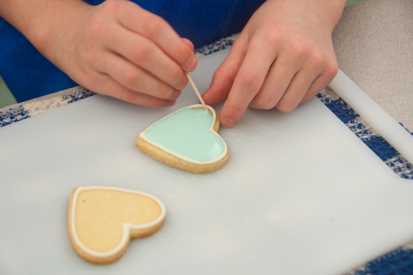 Kids outlining cookies with royal icing on eatlivetravelwrite.com
