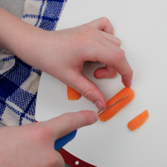 Kids chopping carrots into thin slivers for stir fry on eatlivetravelwrite.com
