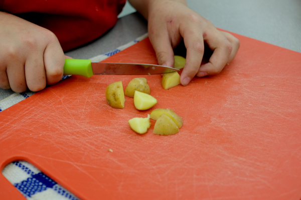 Kids cutting potatoes on eatlivetravelwrite.com