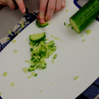 Kids chopping cucumber on eatlivetravelwrite.com