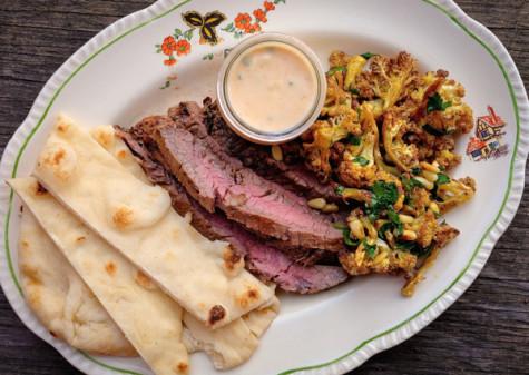 Tandoori marinated flank steak plate and roasted curried cauliflower on eatlivetravelwrite.com