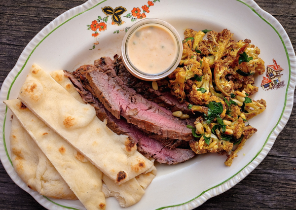 Tandoori marinated flank steak plate and roasted curried cauliflower on eatlivetravelwrite.com