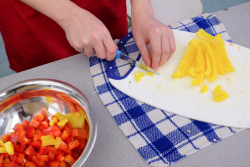 Kids chopping peppers for fried rice on eatlivetravelwrite.com
