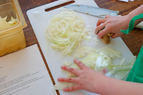 Chopping onions at The Gallery Grill on eatlivetravelwrite.com
