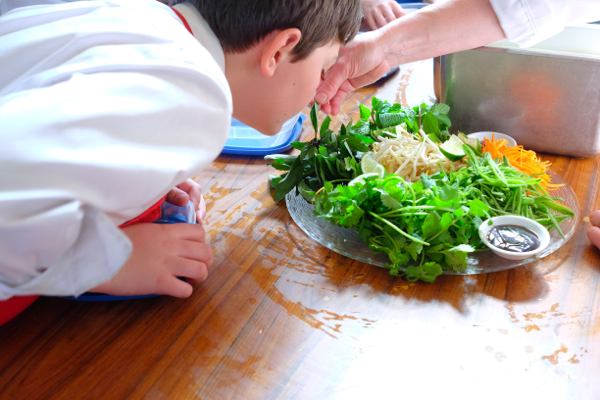 Kids smelling fresh mint at The Gallery Grill on eatlivetravelwrite.com