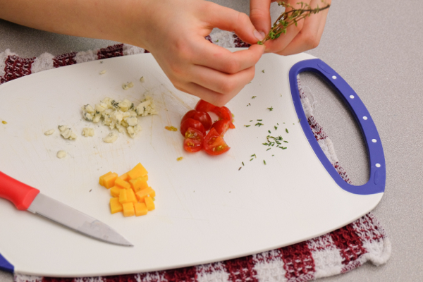 Kids stripping thyme leaves on eatlivetravelwrite.com
