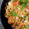 Spaghetti with tomatoes, lemon, feta and arugula on eatlivetravelwrite.com