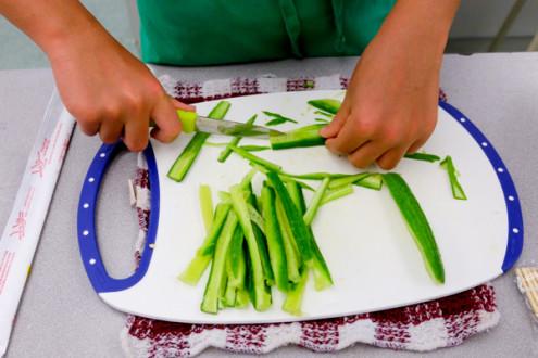 Kids chopping cucumbers for sushi with John Placko on eatlivetravelwrite.com